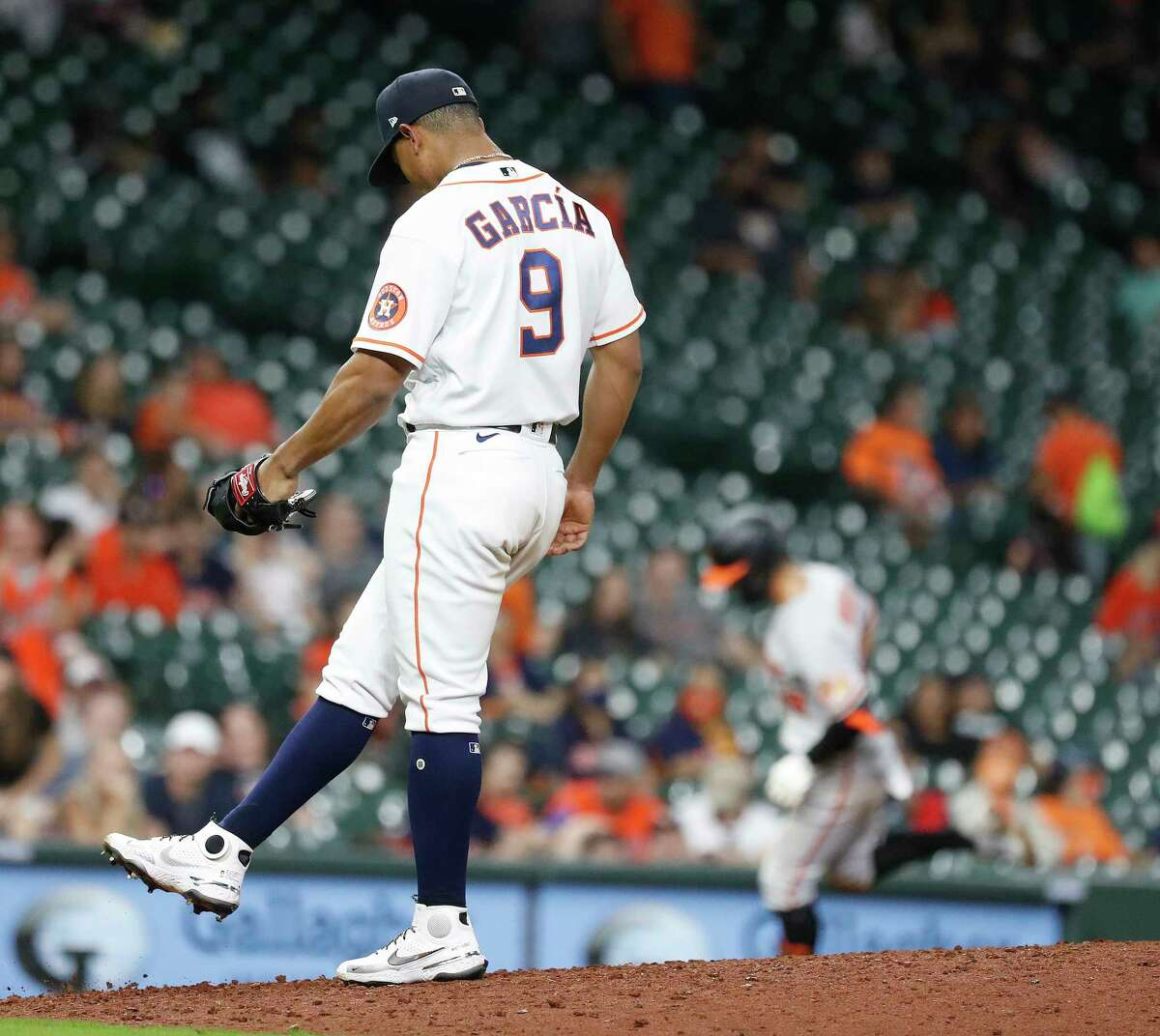 Houston Astros infielder Robel Garcia (9) reacts after giving up a home run to Baltimore Orioles Ramon Urias (29), as he pitched during the ninth inning of an MLB baseball game at Minute Maid Park, Tuesday, June 29, 2021, in Houston.