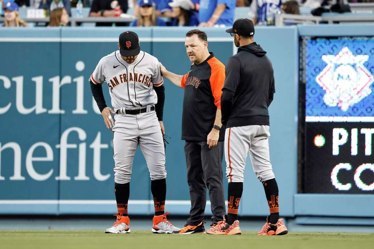 LOS ANGELES, CALIFORNIA - JUNE 29: Mike Tauchman #29 of the San Francisco Giants is checked out after his tumble in the outfield during a game against the Los Angeles Dodgers the third inning at Dodger Stadium on June 29, 2021 in Los Angeles, California. (Photo by Michael Owens/Getty Images)