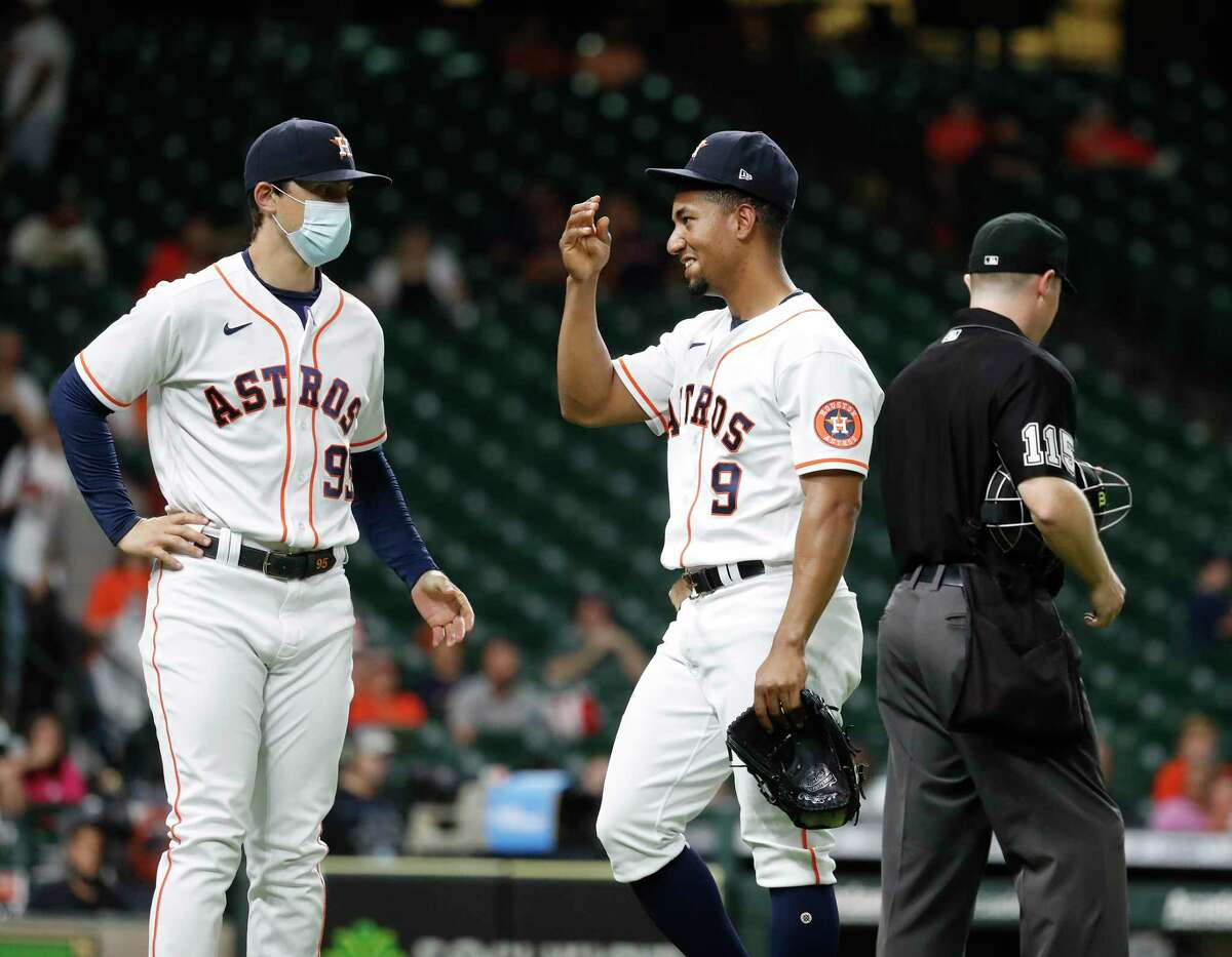 Houston Astros infielder Robel Garcia (9) reacts as he walked back to the dugout after he pitched during the ninth inning of an MLB baseball game at Minute Maid Park, Tuesday, June 29, 2021, in Houston.