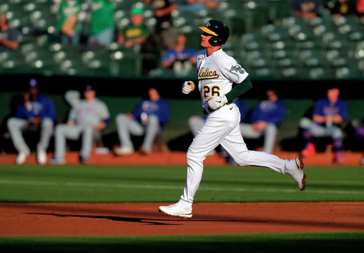 Matt Chapman rounds the basaes after hitting a solo home run in the first inning.