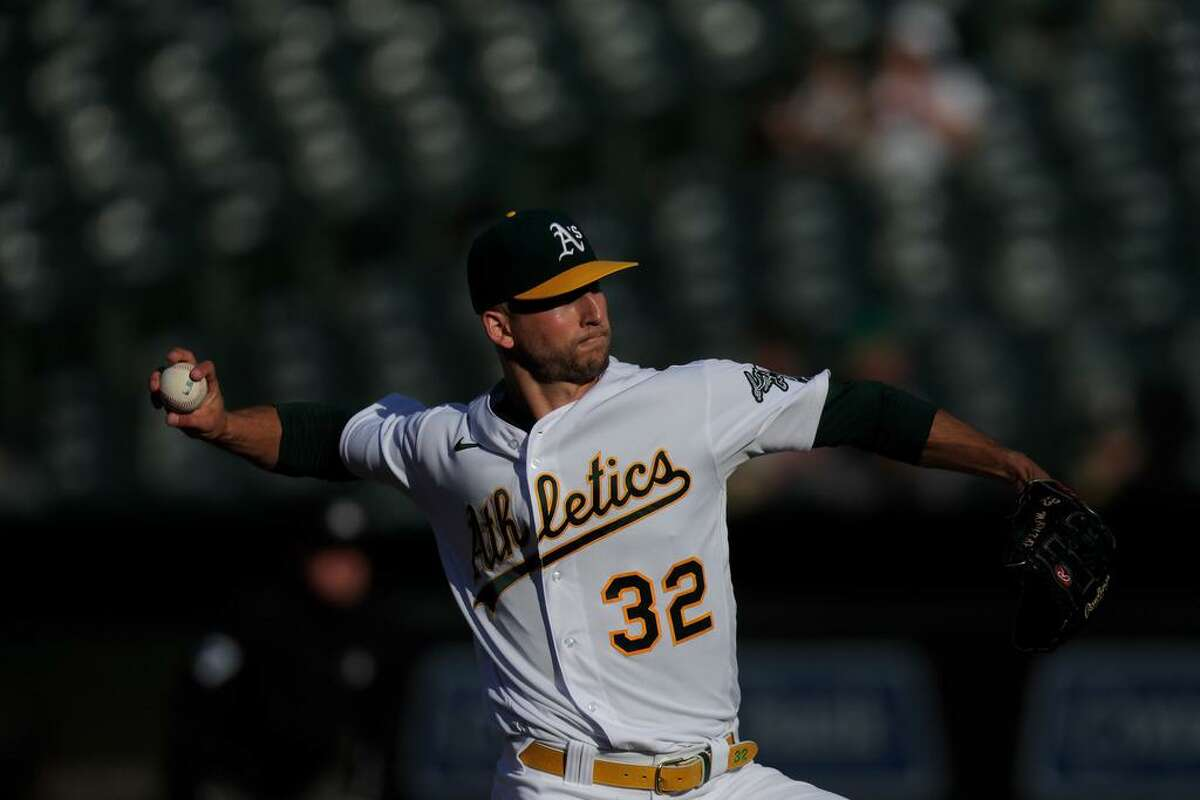 James Kaprielian (32) pitches in the first inning as the Oakland Athletics played the Texas Rangers at the Coliseum in Oakland, Calif., on Tuesday, June 29, 2021.