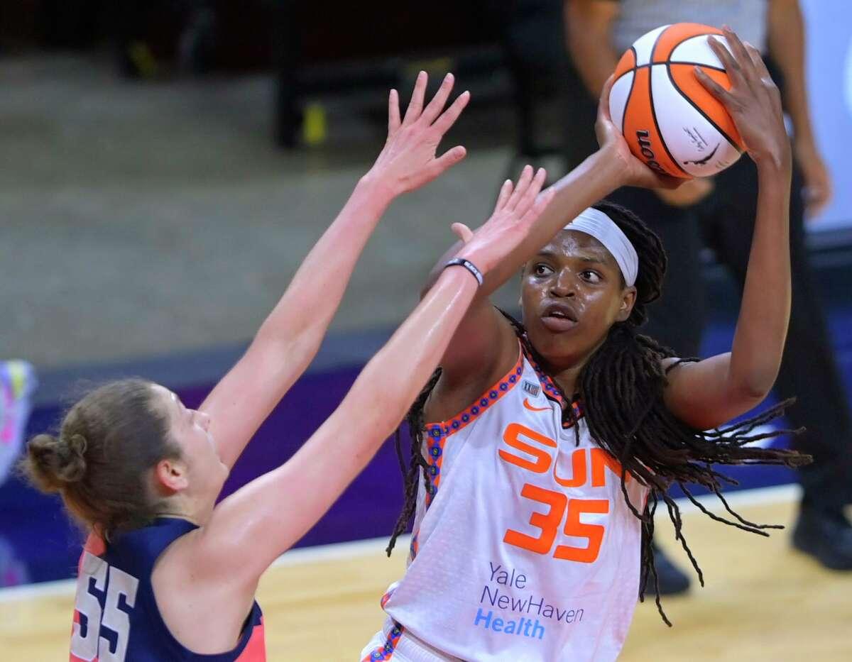 Washington Mystics forward Theresa Plaisance, left, defends against Connecticut Sun forward Jonquel Jones during a WNBA basketball game Tuesday, June 29, 2021, in Washington. (John McDonnell/The Washington Post via AP)