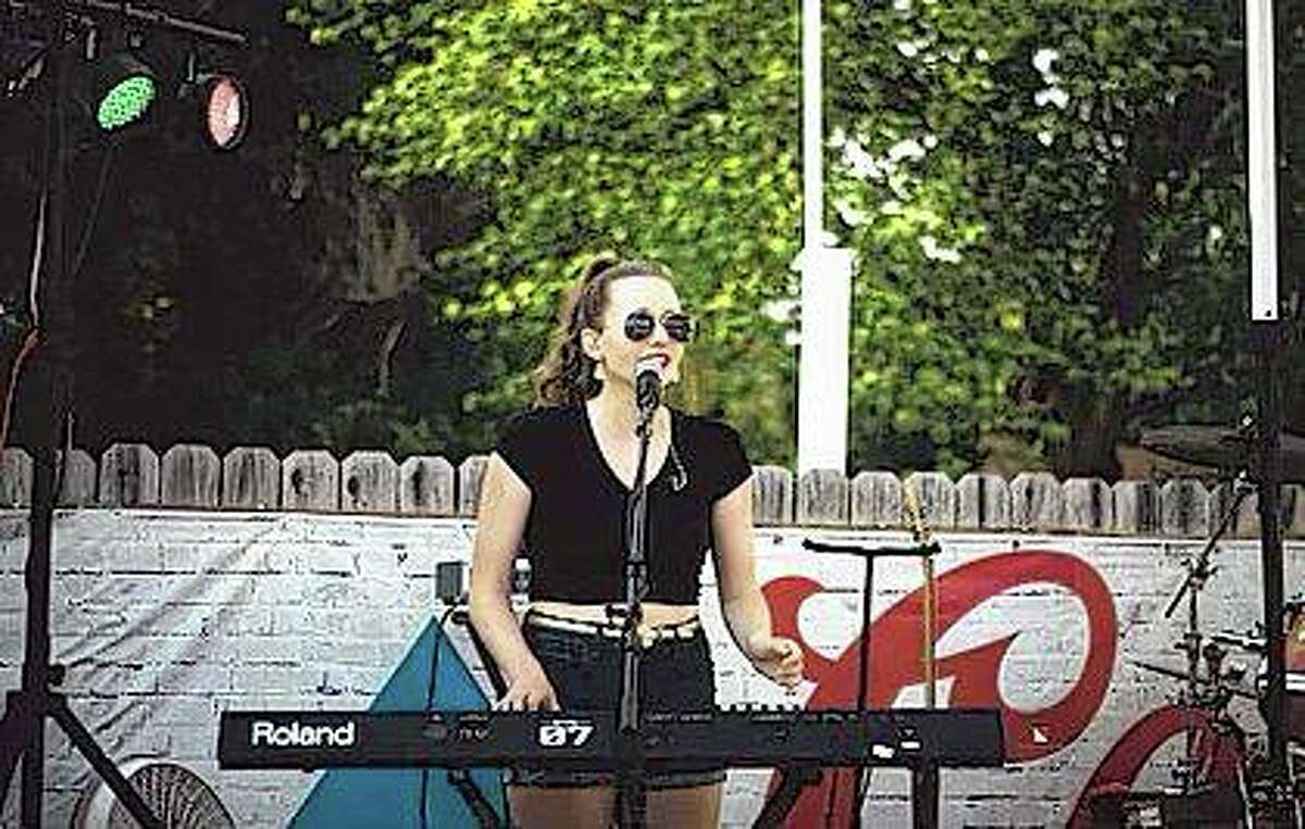 Along with working with a children's theater group in Beardstown, Racquel Rawlins of Beardstown performs in her sister's band, The Aileana Rawlins Band, singing backup vocals and playing the keyboard.