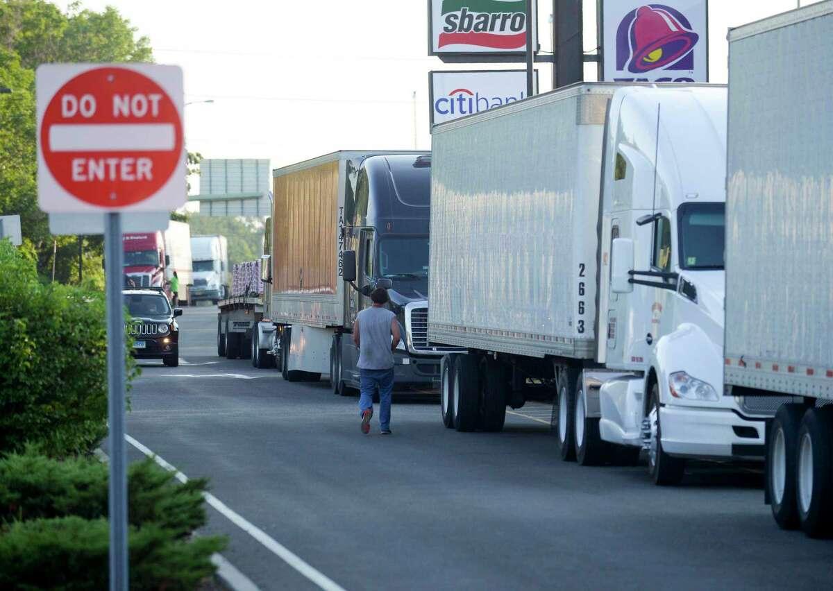 Trucks parked at the Darien Travel Plaza along the I-95 corridor.