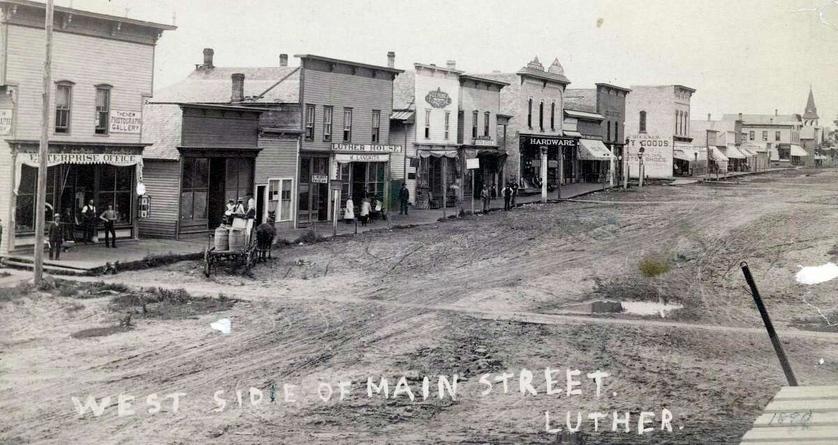 Pictured is the Village of Luther, circa 1890. The memories of Luther pioneer Joe Bull illustrates a picture of the early logging days of Luther and the bustling activity common-place in town well over a century ago. (Courtesy photo)