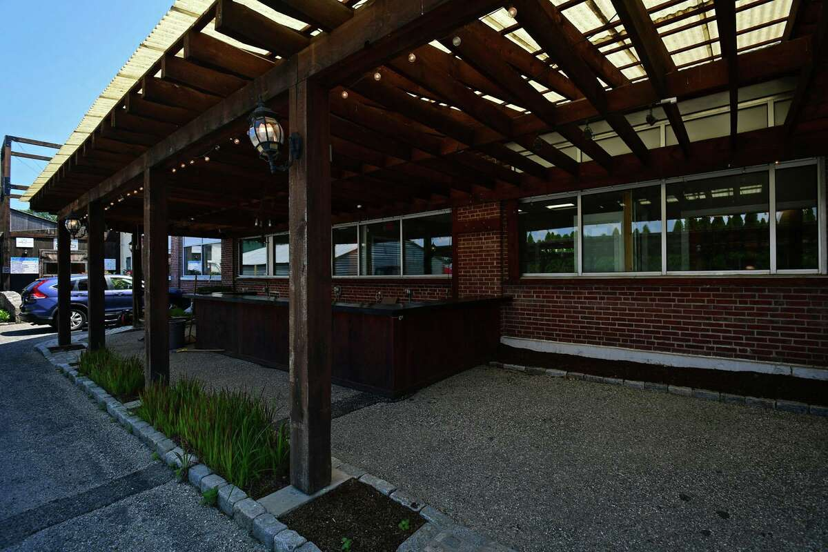 The outdoor area at 314 Wilson Avenue Tuesday, June 29, 2021, in South Norwalk, Conn. The space which includes a bar is being sought by a developer who is seeking city approval to open a farmer's market and beer garden there.