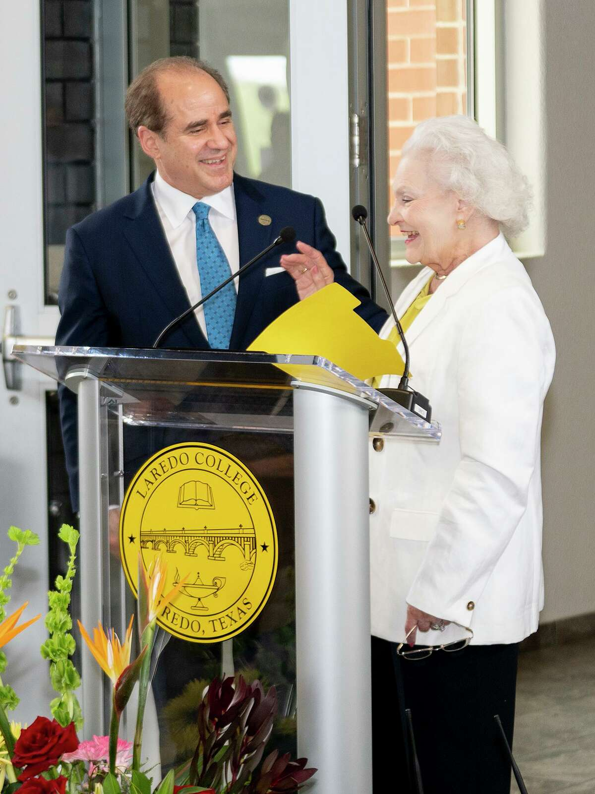 Laredo College President Ricardo Solis welcomes Laredo College Education Foundation President Millie Slaughter to the podium for her remarks Tuesday, June 29, 2021, during Laredo College's Grand Opening Ceremony of the College of Health Sciences located at the South Campus.