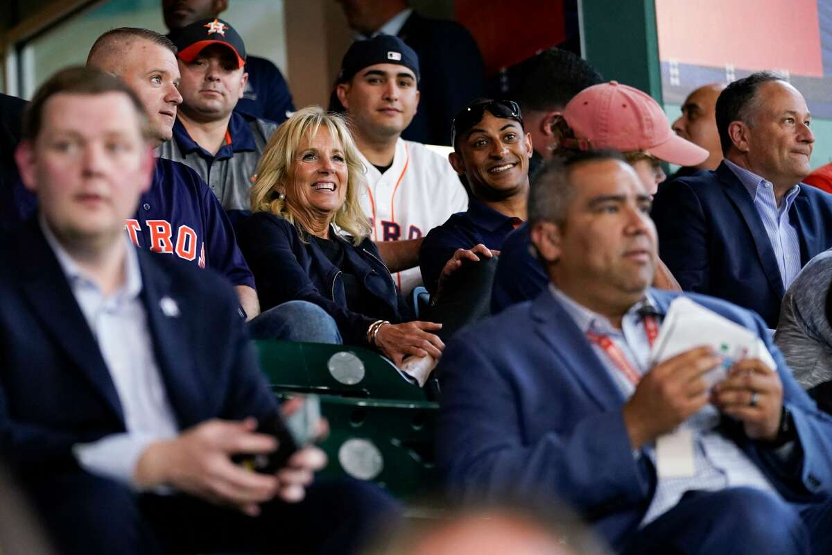 First lady Jill Biden and Second Gentleman Doug Emhoff sit with military members and first responders as they attend a baseball game between the Houston Astros and the Baltimore Orioles at Minute Maid Park, in Houston, Texas, on June 29, 2021. (Photo by Carolyn Kaster / POOL / AFP) (Photo by CAROLYN KASTER/POOL/AFP via Getty Images)