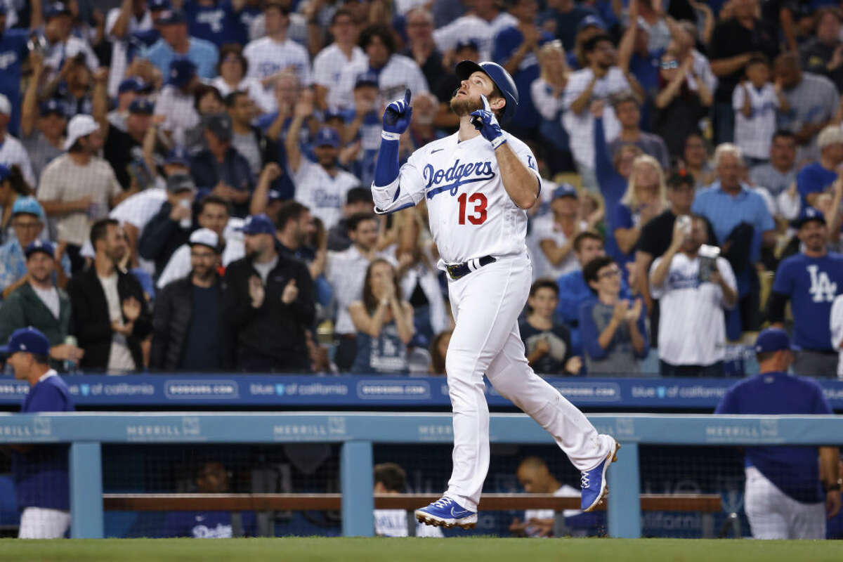 Max Muncy of the Los Angeles Dodgers celebrates as he heads home after hitting a solo home run against the San Francisco Giants during the third inning at Dodger Stadium on June 29, 2021 in Los Angeles, California.