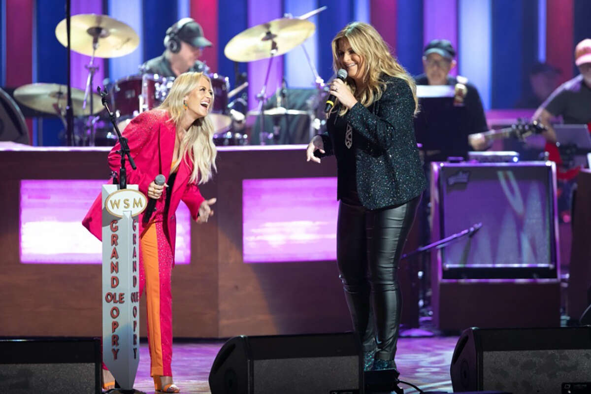 """Brooke Eden, left, and Trisha Yearwood collaborate for Yearwood's 1991 smash, """"She's in Love With the Boy"""" at the Grand Ole Opry in Nashville. They changed the lyrics to """"She's in Love With the Girl"""" in honor of Pride Month and Eden's recent engagement to her partner, Hilary Hoover."""