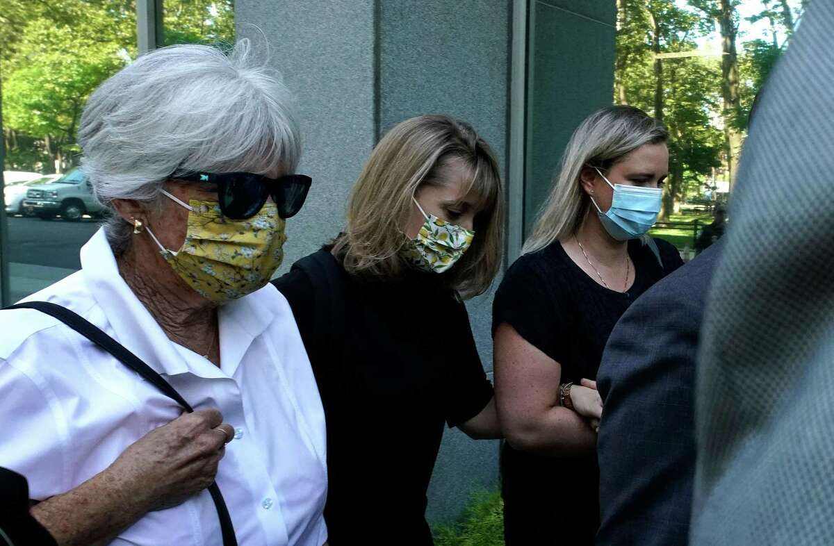 TV actress Allison Mack, second from left,arrives at Brooklyn Federal Court on June 30, 2021 in New York, to be sentenced for her role inNXIVM.(Photo by TIMOTHY A. CLARY / AFP)