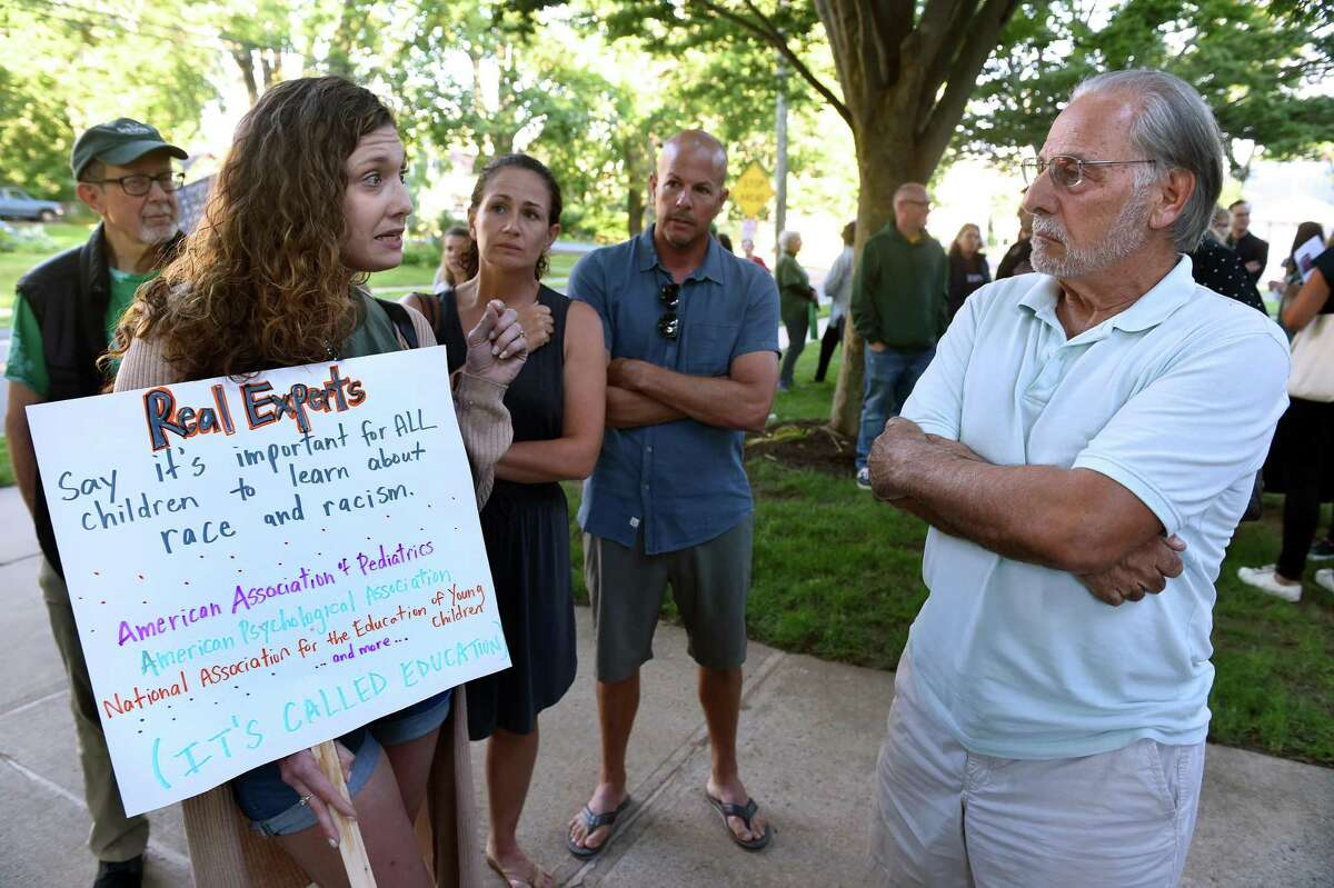 Lauren Dennehy (left) of Guilford speaks with Michael Mauriello of East Haven before a forum on critical race theory at the Nathanael B. Greene Community Center in Guilford on June 24, 2021.