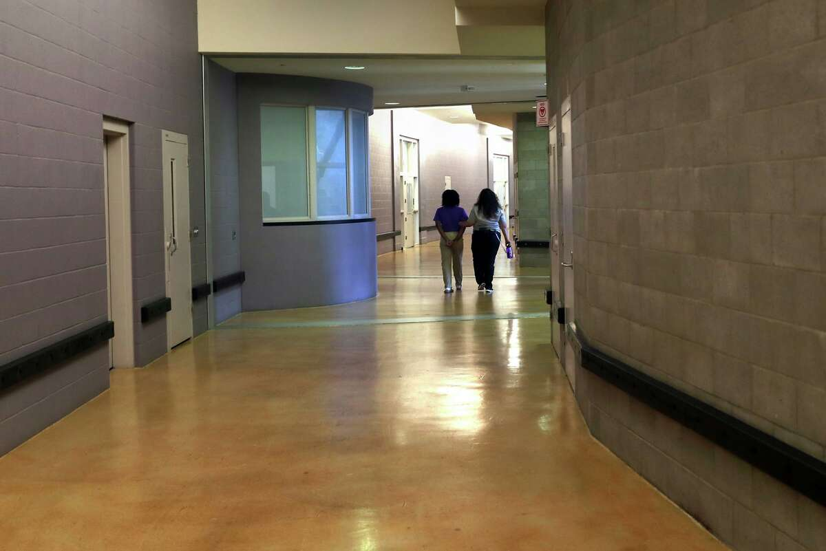 A youth is led back to her unit at Juvenile Hall in San Francisco in 2018.