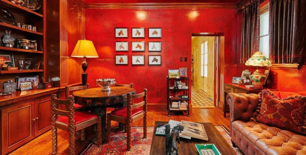 While modern homes tend to shy away from bright wall colors, the Robertson House has another living area with deep-red walls that's giving us Peaky Blinders vibes.