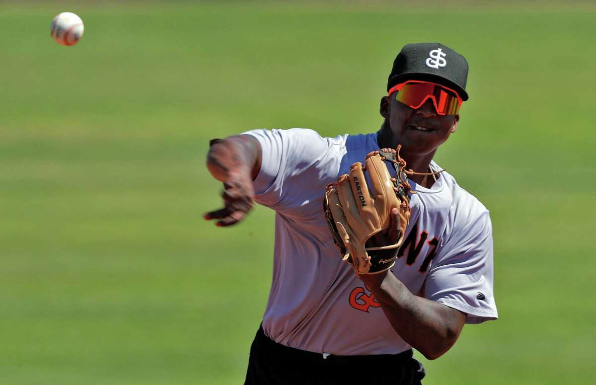 Marco Luciano (10) throws a ball during infield practice at Excite Ballpark before the San Jose Giants played the Modesto Nuts in San Jose, , Calif., on Thursday, June 3, 2021.