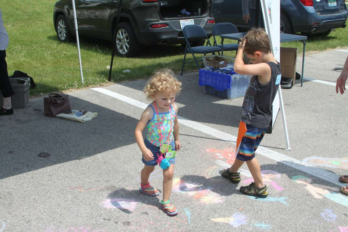 During a past Family Fun Day event during the Manistee National Forest Festival, chalk art was offered for children. This year, organizers plan picnic-type events like an egg toss and pie eating contest.