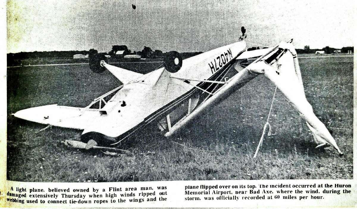 This front page photo from the July 5, 1974 edition shows a small plane at the Huron County airport flipped over after the previous day's high winds. (Tribune File Photo)