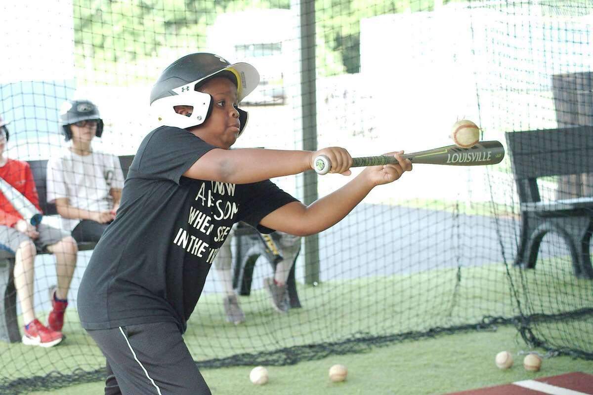 Jordan Reed practices bunting Tuesday at the Bay Area Christian baseball camp.