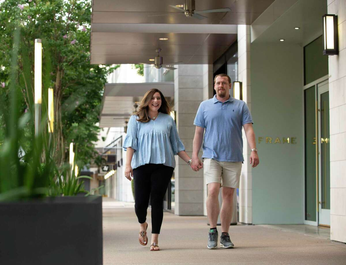 Alondra Martinez and fiance Tyler Knighton pose for a photographon their usual walking route at River Oaks shopping district Friday, June 18, 2021, in Houston. Martinez was overweight, diagnosed with Type 2 diabetes and struggling with her health to the point of going into a diabetic coma. Doctor's advice didn't work, nor did a personal trainer. It wasn't until her then boyfriend told her he was scared of losing her and that couldn't happen because he wanted to marry her -- that she began to take her health seriously.