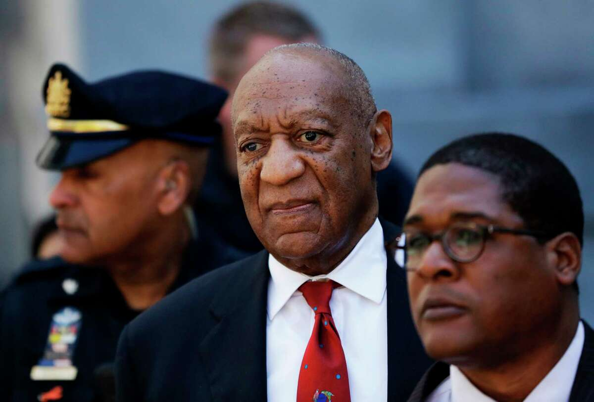 FILE - In this April 26, 2018, file photo, Bill Cosby, center, leaves the the Montgomery County Courthouse in Norristown, Pa. Pennsylvania's highest court has overturned comedian Bill Cosby's sex assault conviction. The court said Wednesday that they found an agreement with a previous prosecutor prevented him from being charged in the case.