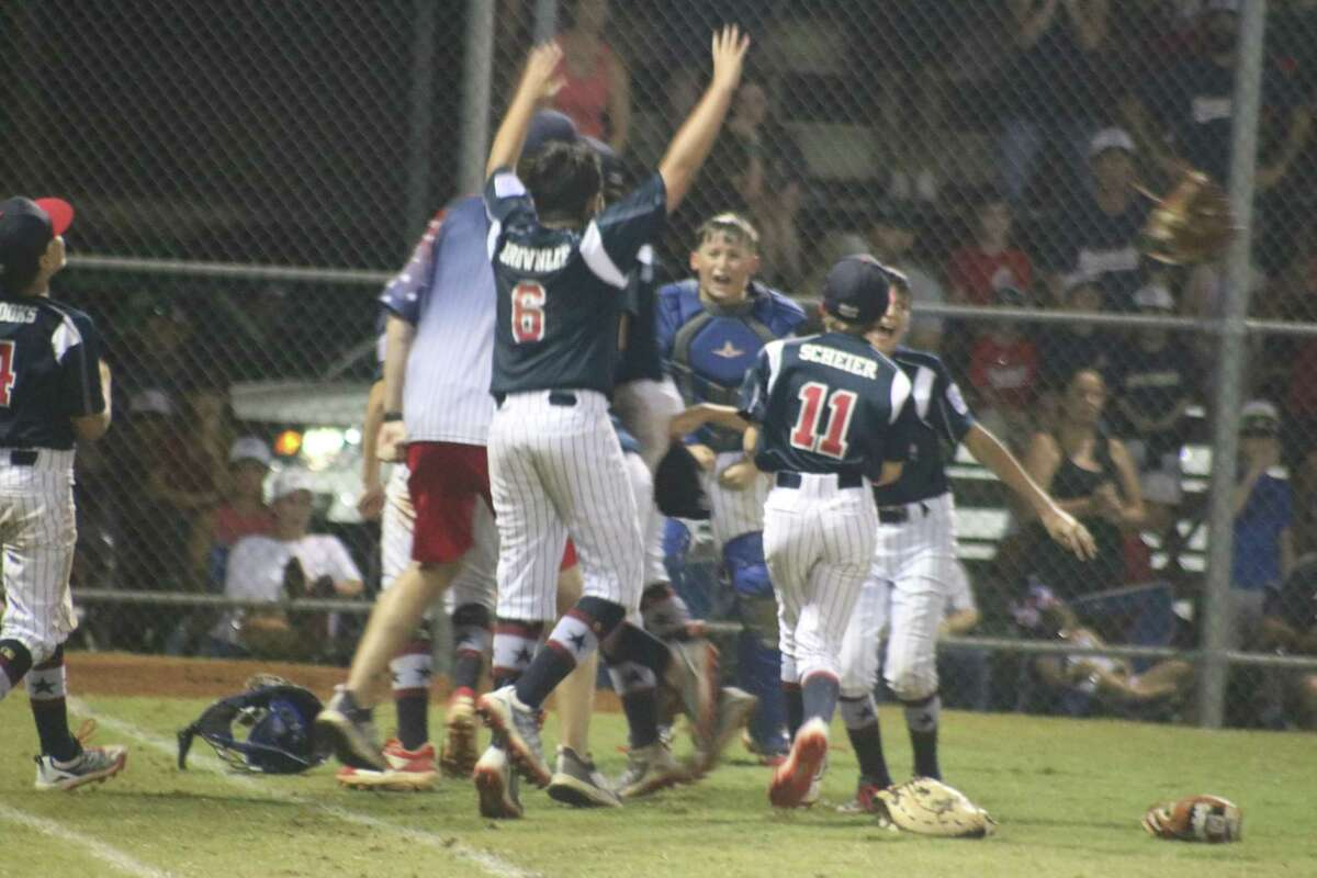 The NASA 12-year-olds begin their district championship celebration Tuesday night, following their 8-6 win over Bayside.