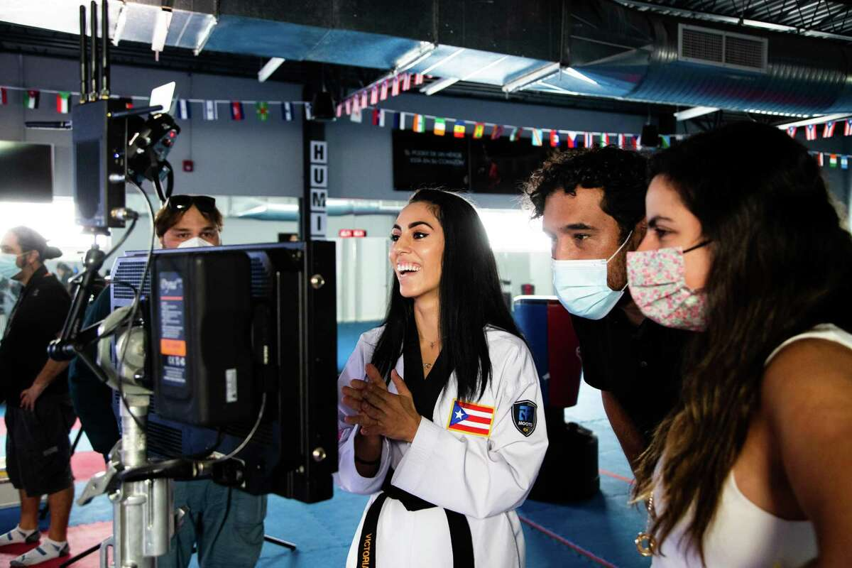 Olympic taekwondo athlete Victoria Stambaugh, 28, reacts as she sees a recording of herself performing as part of a commercial San Juan, Puerto Rico, Thursday, June 10, 2021. Stambaugh, who is from Pasadena but of Puerto Rican descendancy will be representing Puerto Rico in taekwondo in the 2021 Tokyo Olympic Games in July.