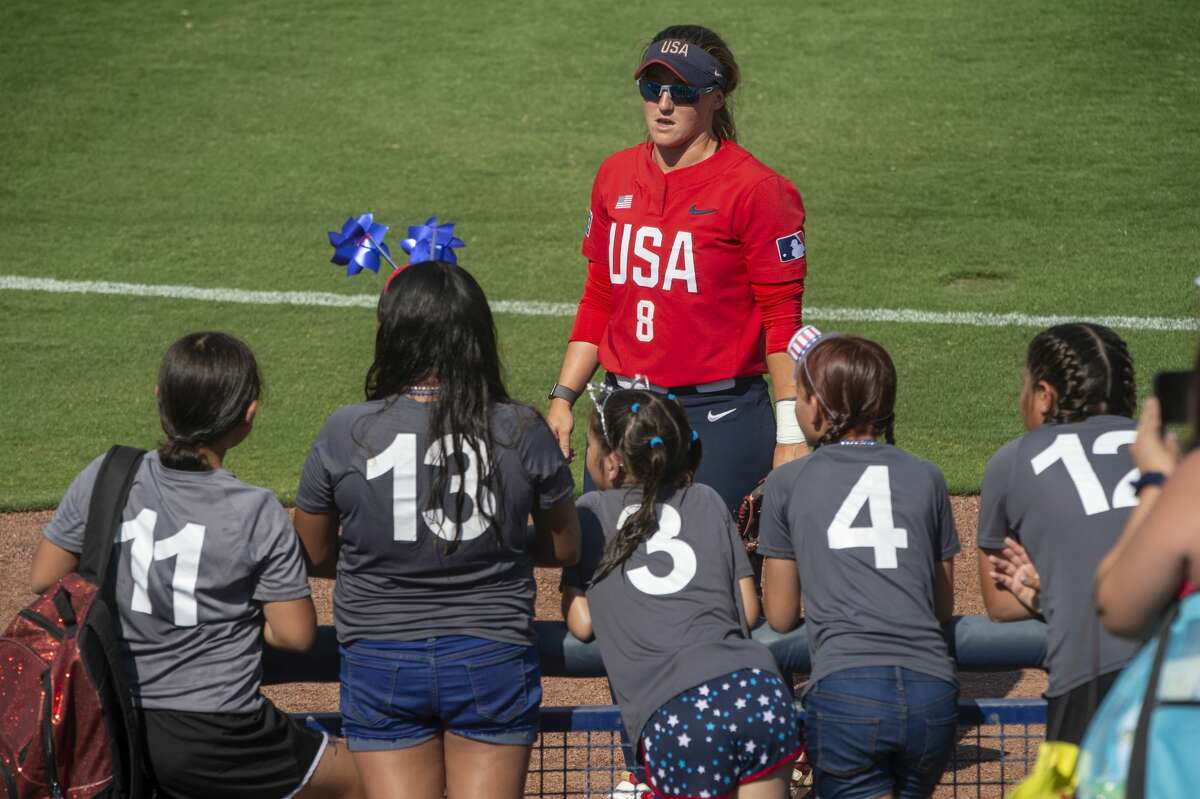 Team USA's Haylie McCleney talks with young softball players 06/11/2021 before the game against Team Alliance at Momentum Bank Ballpark. Tim Fischer/Reporter-Telegram