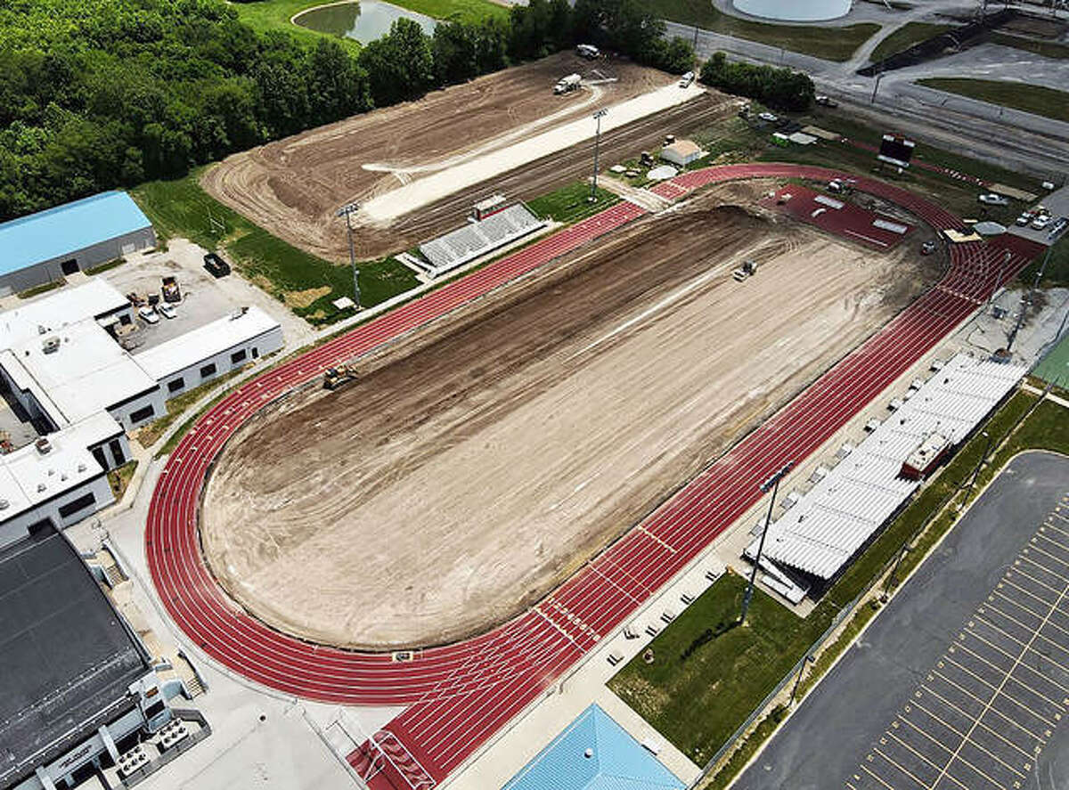 An aerial view of Charles Raich Field at Roxana High School after the natural grass was removed and foundation material had been installed waiting for crushed rock to be laid on top of that. AstroTurf will be installed on the football field and on a soccer field being built. The soccer field is visible at the top of the photo. The project is about half complete. Plans call for the beginning of turf installation the second week of July and the project to be completed by Aug. 6 in time for next fall's football and boys soccer seasons .
