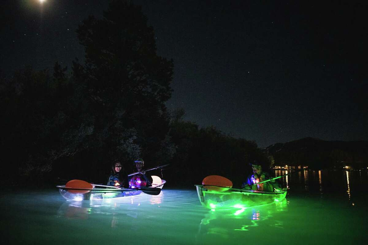 Kayakers on a night tour with Clearly Tahoe.