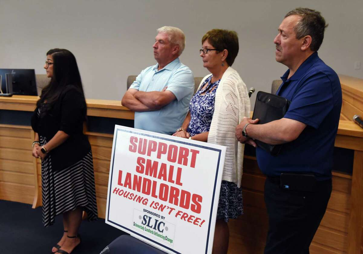 Landlords Rosie Karame, left, Dennis and Mary Ryan, and Joseph Tronco, right, listen as senators Daphne Jordan and Jim Tedisco push for relief from the state pandemic evictions moratorium aimed at helping tenants during lockdown on Wednesday, June 30, 2021, during a press conference at Halfmoon Town Hall in Halfmoon, N.Y. (Will Waldron/Times Union)