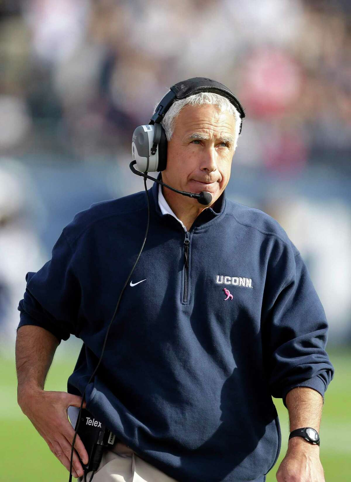 Connecticut head coach Paul Pasqualoni walks on the sidelines in the fourth quarter of an NCAA college football game against Temple in East Hartford, Conn., Saturday, Oct. 13, 2012. Temple won 17-14 in overtime. (AP Photo/Michael Dwyer)