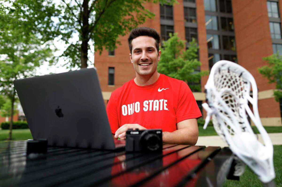 Ohio State lacrosse player Mitchell Pehlke, an aspiring YouTube personality who broadcasts a channel to 14,000 subscribers, poses for a photo outside his dorm at Ohio State University in Columbus, Ohio, on May 3, 2021. Pehlke has been cultivating his online following for years. When NCAA athletes are finally able to monetize their fame without compromising their eligibility, Pehlke is ready to restart the business of his brand.