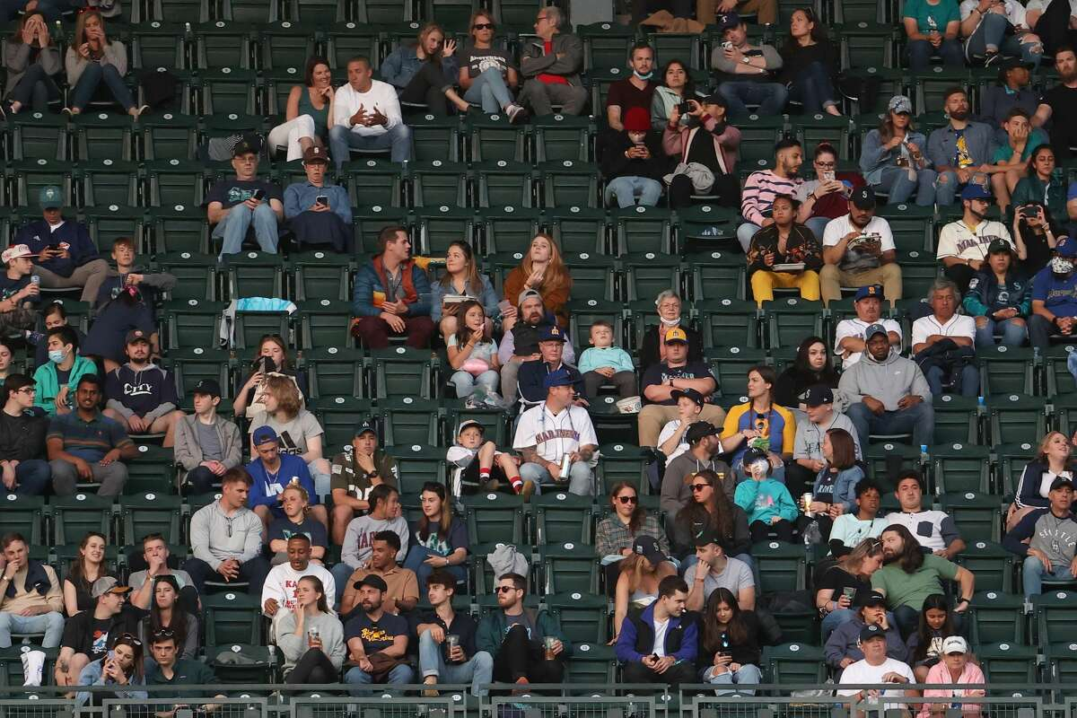 SEATTLE, WASHINGTON - MAY 29: Fans watch play during a game between the Seattle Mariners and Texas Rangers at T-Mobile Park on May 29, 2021 in Seattle, Washington. (Photo by Abbie Parr/Getty Images)