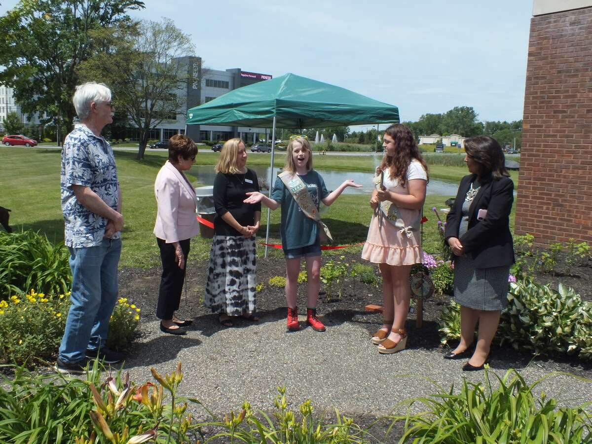 After months of hard work Girl Scout Cadettes Schuyler Klee and Gianna Lorusso held a ribbon-cutting ceremony on Friday, June 25 to showcase their Silver Award project - a pollinator garden outside the William K. Sanford Town Library in Colonie.