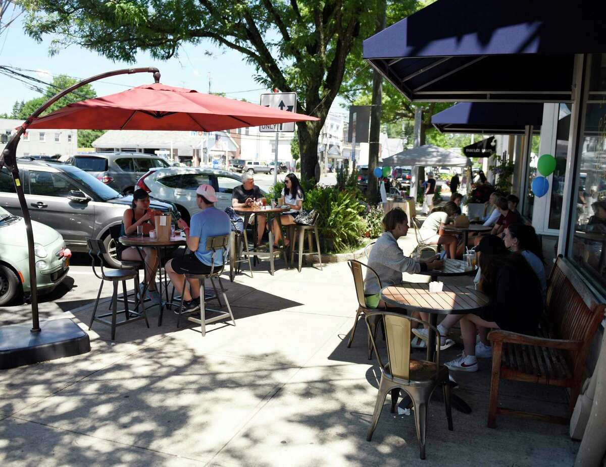 Diners outside Sweet Pea's Baking Company in Greenwich, Conn., in June 2021. Leisure and hospitality jobs accounted for half of all U.S. hiring in June, according to ADP, with the economy registering the third biggest monthly gain in the past year.