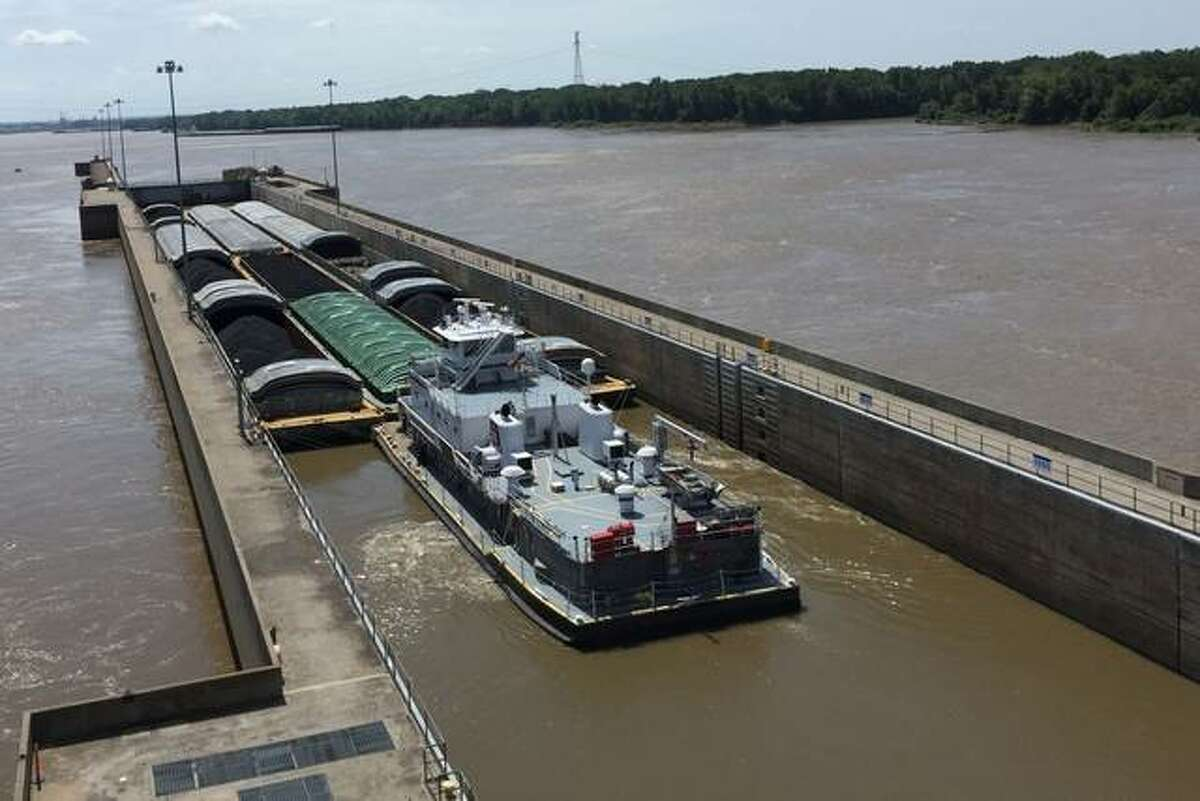 Barges move through the Melvin Price Locks and Dam in Alton. People can learn more about the facility at the nearby National Great Rivers Museum.