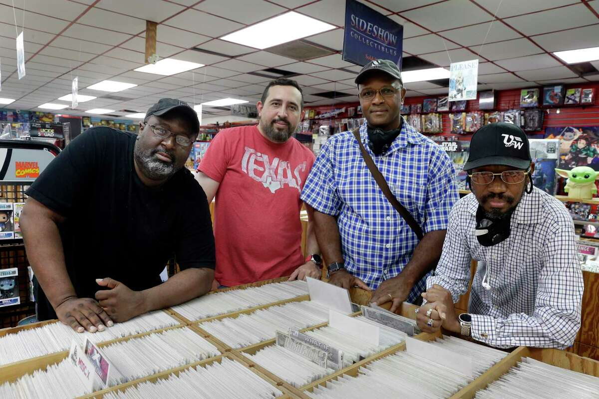 From left, Michael Charles, Benjamin Carbonero, Maurice Terry Jr. and Michael Brooks, long time customers of Third Planet Sci-Fi Superstore, a comics shop that has been around for 45 years, inside the shop Tuesday, June 29, 2021 in Houston, TX. The four are artists/illustrators who contributed comic book art for the lawsuit filed against the adjacent Crown Plaza Hotel, accusing it of allowing its tenants to throw objects from the balconies onto the roof of the comics shop, causing damage to the building and contents.