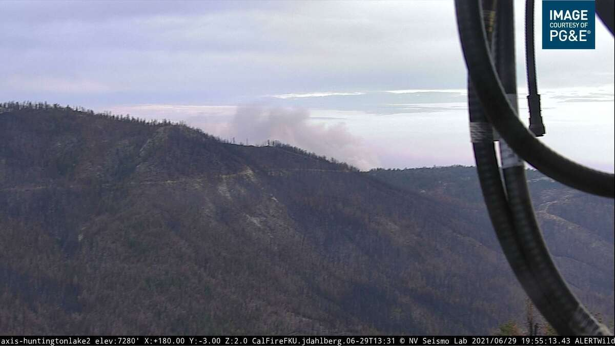 An image from a wildfire camera showing smoke from the Blue Fire burning through a southwest portion of the Sierra National Forest near the Bretz Mill campgrounds in Fresno County.