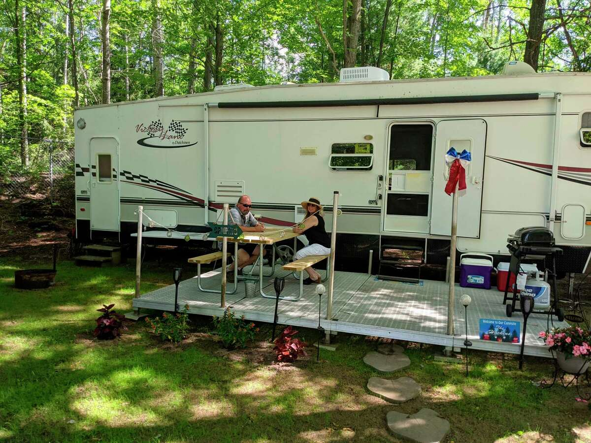 Gordie Huckins left, and wife Carrie, who opened Northern Sites Campground on the River, spend time at their own campsite. The pair are addicted to the outdoors and enjoy camping in all seasons. (Photo by Tereasa Nims)