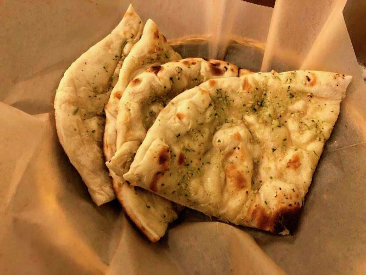 In this author's eye, noIndian meal is complete without naan - a oven-baked flatbread - so I ordered a side of garlic naan to go with my meal at Idli Dosa. (Victoria Ritter/vritter@mdn.net)