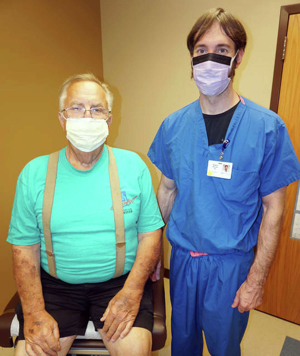 Paul Waters of Bunker Hill is shown with Dr. Matthew Musielak, the surgeon at Alton Memorial Hospital who leads the Bariatrics program. Through the program, Waters has lost 59 pounds.