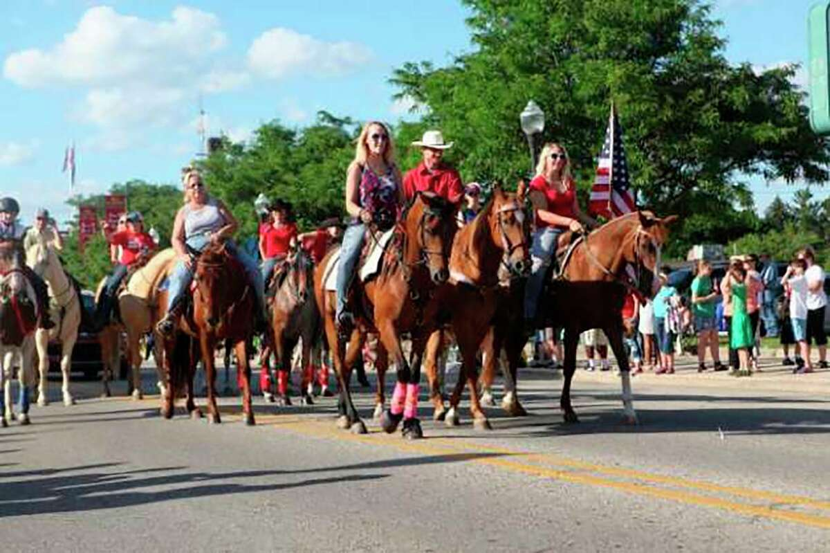The Big Rapids Equestrian Team rides down Michigan Avenue, showing off their prized companions during the Fourth of July parade in 2017. (Pioneer file photo)