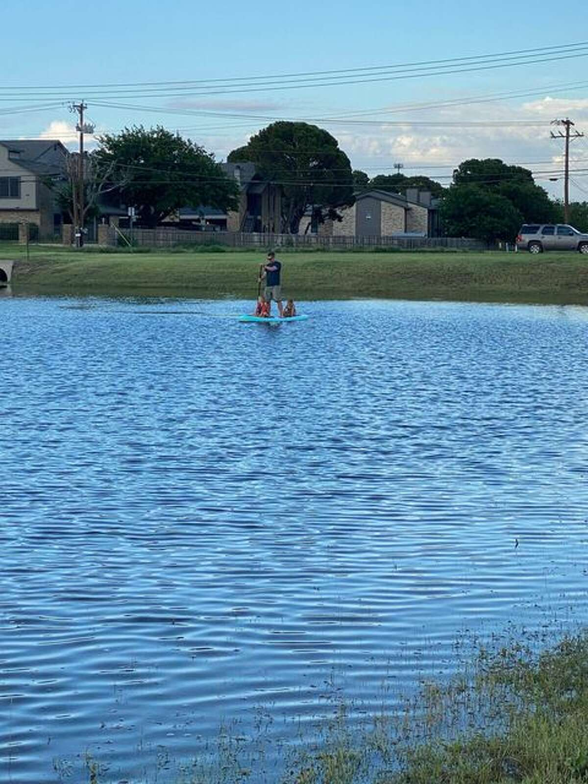 Midlanders took advantage of a flooded drainage ditch across from Bowlero after series of storms dumped several inches of rain in Midland and across parts of West Texas.
