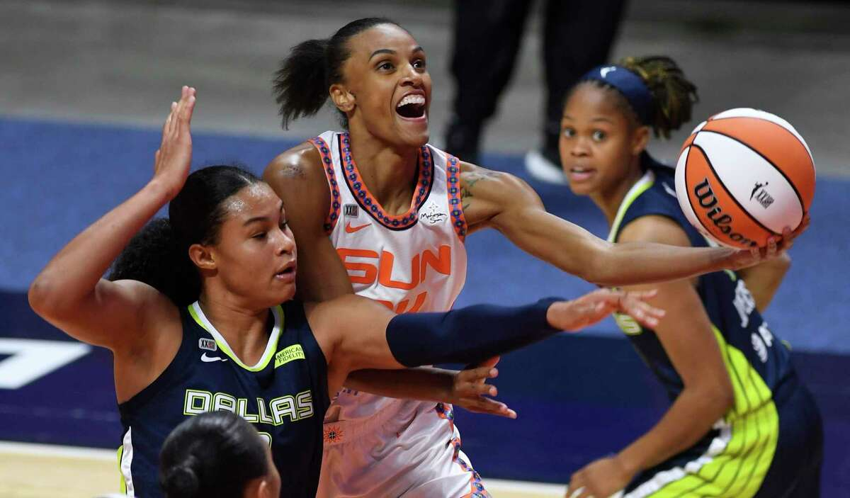 Connecticut Sun forward DeWanna Bonner is fouled on a drive by Dallas Wings forward Satou Sabally during the second half of a WNBA basketball game Tuesday, June 22, 2021 at Mohegan Sun Arena in Uncasville, Conn. (Sean D. Elliot/The Day via AP)