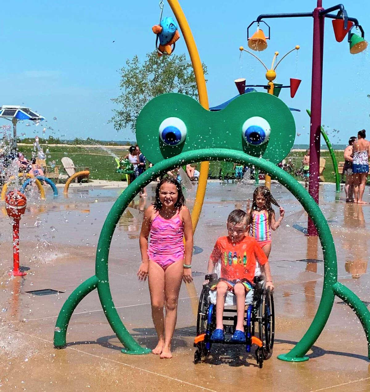 Chase and his sister Kennadi enjoying the splash pad in Bay City.