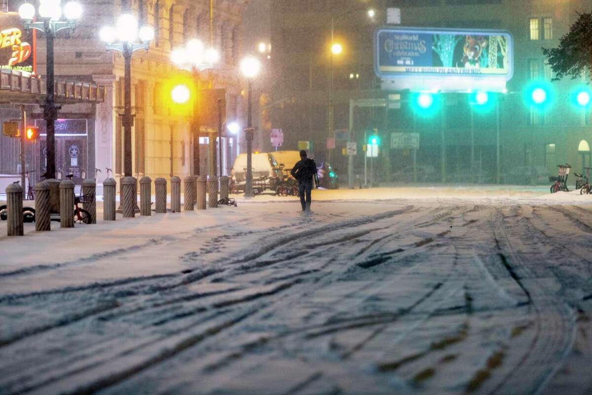 A lone person is seen walking during the morning of February 15 in the snow on Alamo Street, in the direction of Houston Street.  The Farmers Almanac previously predicted Texas 'Uri winter storm, in which heavy snowfall, ice storms and bitter temperatures caused a huge strain on the state's electricity grid, leaving millions without electricity.  More than 200 people died.