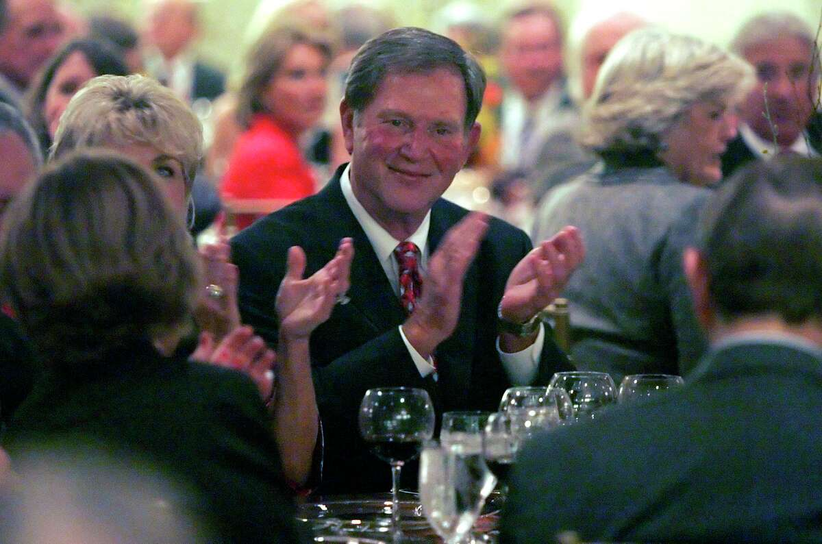 Larry Walker, 79, a former publisher and CEO of the San Antonio Express-News, at his retirement party in 2006. Readers reflect on his life and the impact he had on this newspaper and our community.