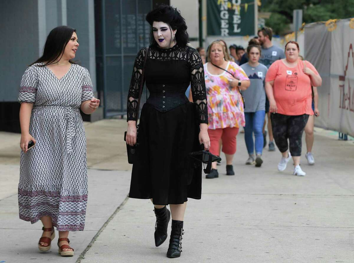Sisters Grimm Ghost Tours owner Lauren Swartz, left, chats with her tour guide Mae Morrow before a group embarks on a tour on Tuesday, June 29, 2021.