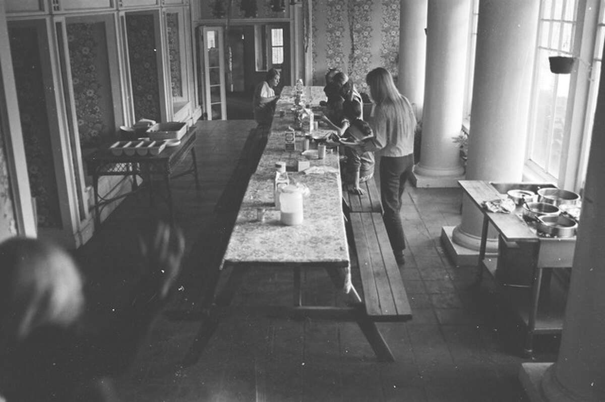 The dining room inside the Burdell Mansion during the chosen family's residence.