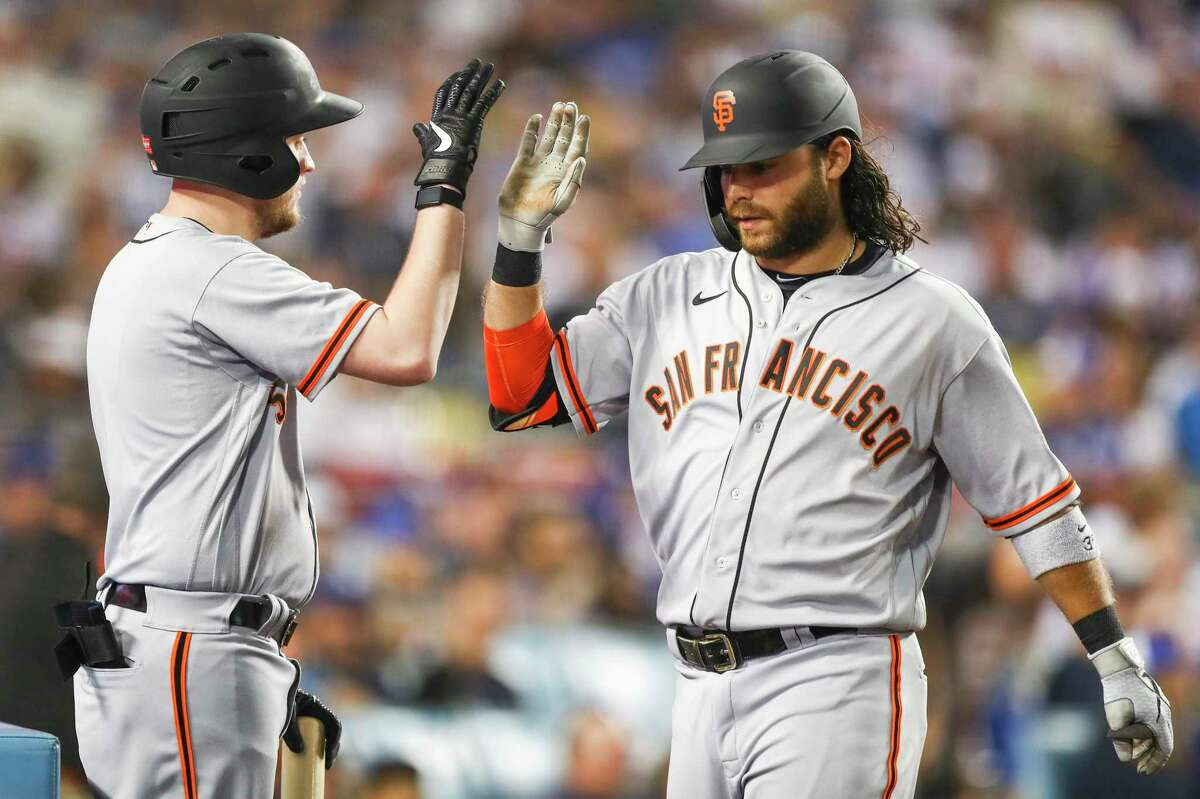LOS ANGELES, CALIFORNIA - JUNE 28: Brandon Crawford #35 of the San Francisco Giants celebrates his home run in the sixth inning against the Los Angeles Dodgers at Dodger Stadium on June 28, 2021 in Los Angeles, California. (Photo by Meg Oliphant/Getty Images)